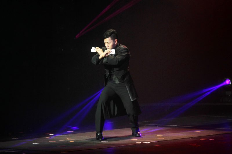 "An Ha Lim, also known as ""The Manipulator"" dressed in full tuxedo, crosses his arms preparing for his magic trick."