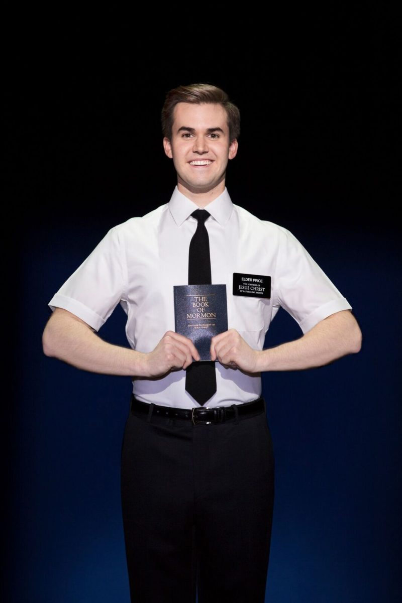 Handsome Mormon shows off his copy of The Book of Mormon