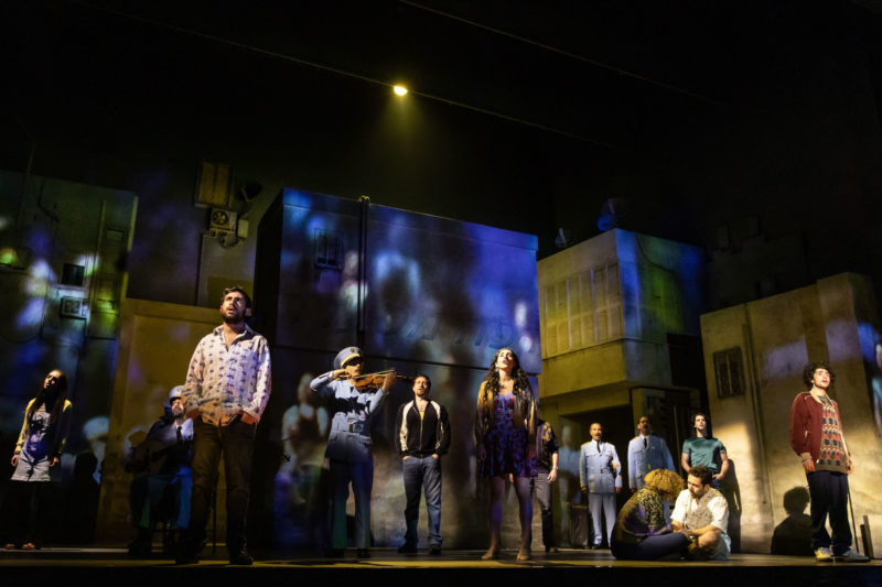 The cast of THE BAND'S VISIT sing the finale as the sun rises on Bet Hatikva.