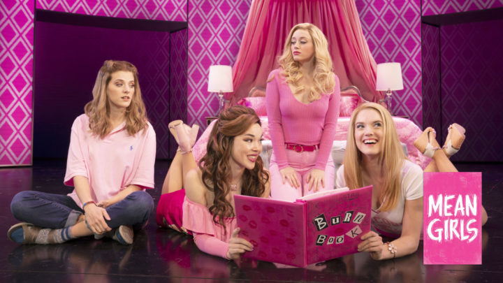 The Plastics and Cady Heron sit in Queen Bee Regina George's bedroom reading the Burn Book full of awful thoughts about their classmates and teachers
